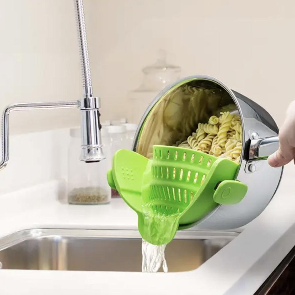 """Add this directly to the pot, and free your pasta from its hot juices in seconds while also sparing you storage space. Psst — these are a game changer for washing your fruit, too!<br /><br /><strong>Promising review:</strong>""""I've owned this for about six months, and I couldn't imagine cooking without it. I hate strainers. They are bulky and fill up the dishwasher, I'm lazy, whatever. This strainer is a lifesaver.<strong>Clip it on your pan, strain, and voila! And it is so easy to clean.</strong>A little hot water and it's good to go for the next round.<strong>I highly recommend this gadget, it will retire your current strainer.</strong>"""" —<a href=""""https://www.amazon.com/gp/customer-reviews/R164G1YTWQ4GYY?ascsubtag=5310069%2C11%2C29%2Cd%2C0%2C0%2Cbf%2C805%3Anull%3B804%3Anull%3B776%3Anull%3B817%3A1%3B745%3A1&linkCode=ll2&tag=huffpost-bfsyndication-20&linkId=d6c6c7b4643ef02960edabf1dca8fac7&language=en_US&ref_=as_li_ss_tl"""" target=""""_blank"""" rel=""""noopener noreferrer"""">Viola Evens</a><br /><br /><strong>Get it from Amazon for<a href=""""https://www.amazon.com/Kitchen-Gizmo-Strainer-Silicone-Colander/dp/B018W9JII0?&linkCode=ll1&tag=huffpost-bfsyndication-20&linkId=3c22dc3181aef4ad9b7d59ca69f39452&language=en_US&ref_=as_li_ss_tl"""" target=""""_blank"""" rel=""""noopener noreferrer"""">$15.99</a>(available in five colors).</strong>"""
