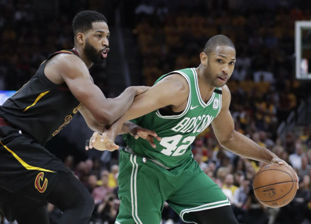 Boston Celtics' Al Horford (42), from Dominican Republic, drives on Cleveland Cavaliers' Tristan Thompson in the second half of Game 4 of the NBA basketball Eastern Conference finals, Monday, May 21, 2018, in Cleveland. (AP Photo/Tony Dejak)
