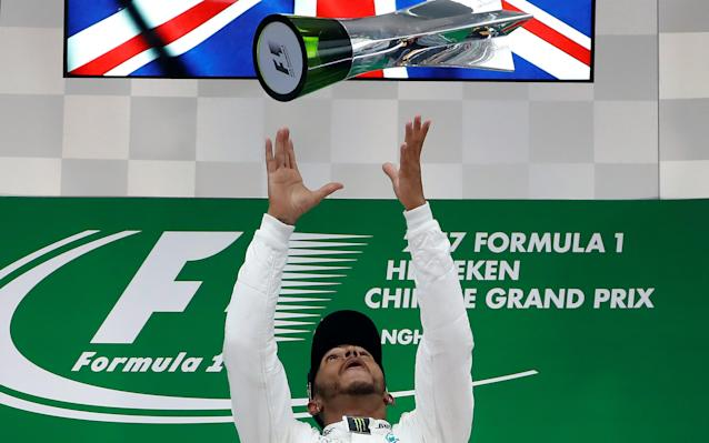 Hamilton celebrates victory in Shanghai - Reuters