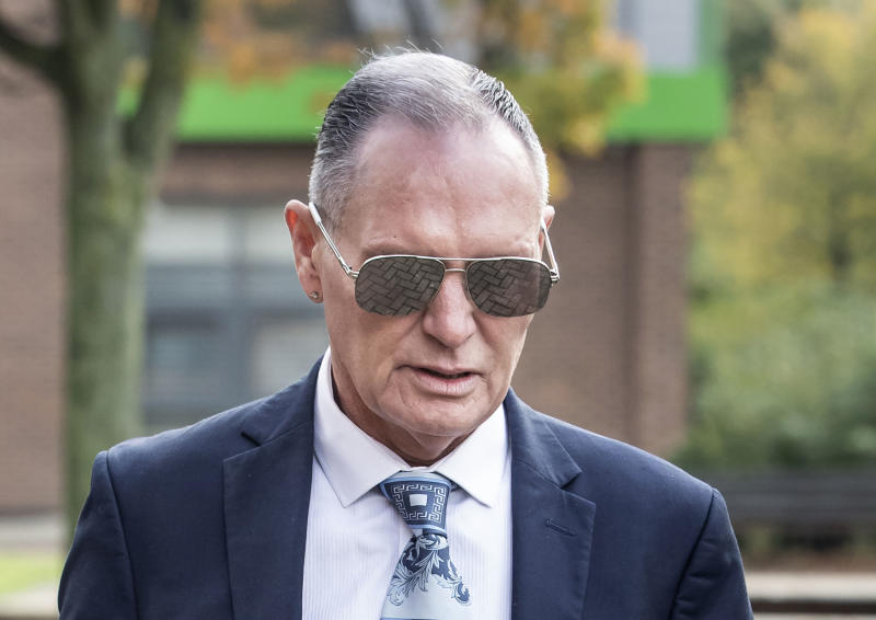 Former England soccer player Paul Gascoigne arrives at Teesside Crown Court in Middlesbrough, England where he is appearing on charges of sexually assaulting a woman on a train, Monday Oct. 14, 2019. (Danny Lawson/PA via AP)