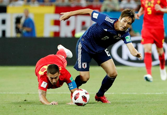 <p>Japan's Genki Haraguchi in action with Belgium's Eden Hazard REUTERS/Jorge Silva </p>