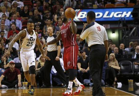Dec 16, 2013; Miami, FL, USA; Miami Heat small forward LeBron James (6) reacts to an injury in the third period as Utah Jazz shooting guard Brandon Rush (25) at American Airlines Arena. Robert Mayer-USA TODAY Sports