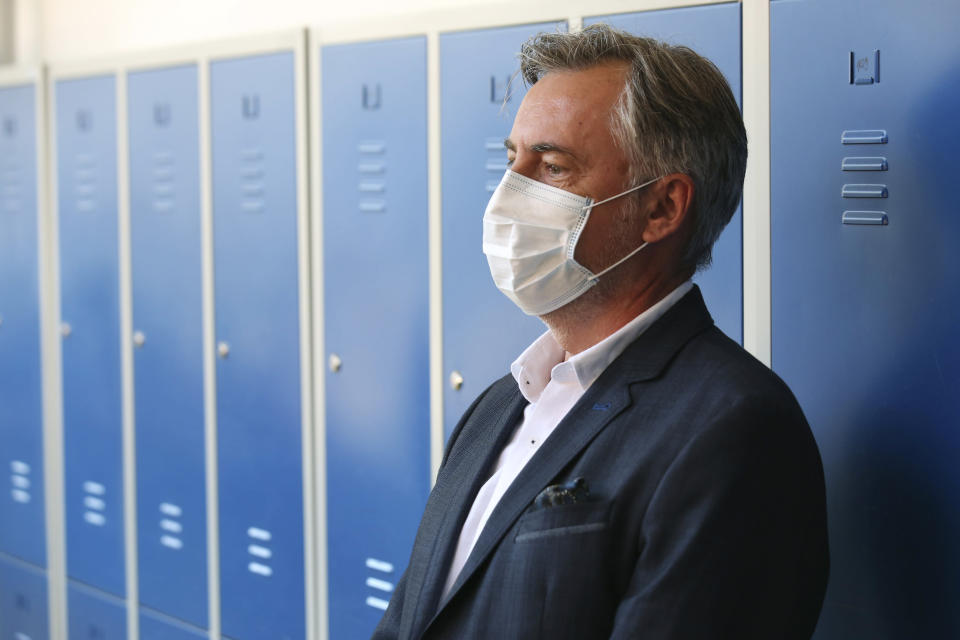 Miroslav Skoro, leader of the Homeland Movement wears a face mask at a polling station in Zagreb, Croatia, Sunday, July 5, 2020. Amid a spike of new coronavirus cases, voters in Croatia cast ballots on Sunday in what is expected be a close parliamentary race that could push the latest European Union member state further to the right. (AP Photo/Daniel Kasap)