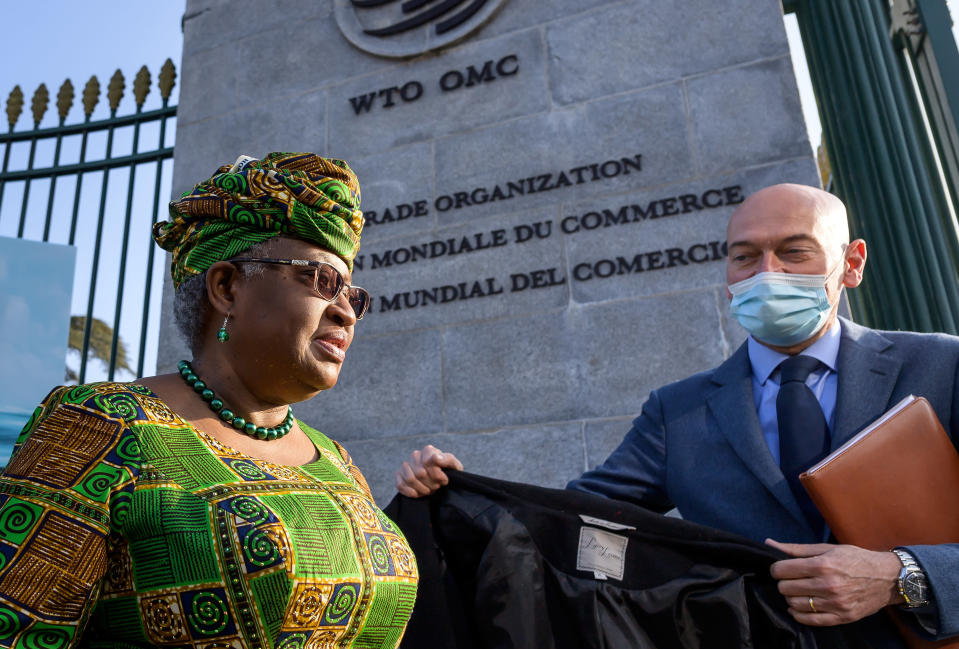"""FILE - In this Monday, March 1, 2021 file photo, New Director-General of the World Trade Organisation Ngozi Okonjo-Iweala, left, walks at the entrance of the WTO, following a photo-op upon her arrival at the WTO headquarters to take office in Geneva, Switzerland. The head of the World Trade Organization has called for for expanded vaccine manufacturing capability in developing countries. WTO Director-General Ngozi Okonjo-Iweala said Thursday, April 1, 2021 that """"vaccine inequity"""" during the coronavirus pandemic demonstrates the need for developing nations to be able to make vaccines. She said, """"The idea that 70% of vaccines today have been administered only by 10 countries is really not acceptable."""" (Fabrice Coffrini/Pool/Keystone via AP, FIle)"""