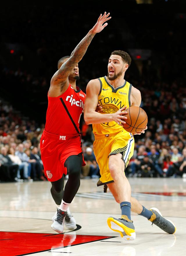 PORTLAND, OR - DECEMBER 29: Klay Thompson #11 of the Golden State Warriors drives against Damian Lillard #0 of the Portland Trail Blazers at Moda Center on December 29, 2018 in Portland, Oregon.(Photo by Jonathan Ferrey/Getty Images)
