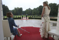 Queen Maxima of the Netherlands, right, and Elke Buedenbender, wife of German President Frank-Walter Steinmeier, wait for the military welcome ceremonial at the Bellevue palace in Berlin, Germany, Monday, July 5, 2021. The Dutch Royals arrived in Germany for a three-day visit that was delayed from last year because of the coronavirus pandemic. (Wolfgang Kumm/dpa via AP)