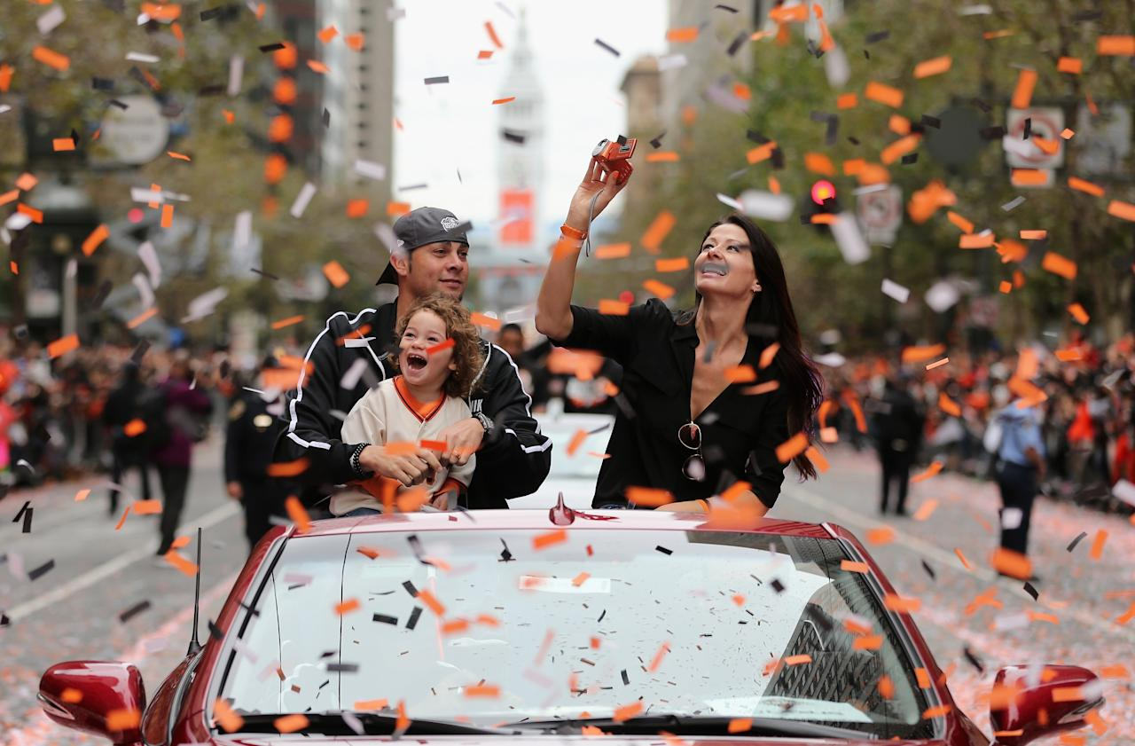SAN FRANCISCO, CA - OCTOBER 31:  Ryan Vogelsong #32 of the San Francisco Giants waves to the crowd during the San Francisco Giants World Series victory parade on October 31, 2012 in San Francisco, California. The San Francisco Giants beat the Detroit Tigers to win the 2012 World Series.  (Photo by Ezra Shaw/Getty Images)