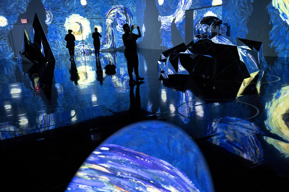 Projections of selected works of celebrated painter Vincent Van Gogh are displayed at a preview of the Immersive Van Gogh exhibit at Pier 36, Friday, June 4, 2021, in New York. (AP Photo/John Minchillo)