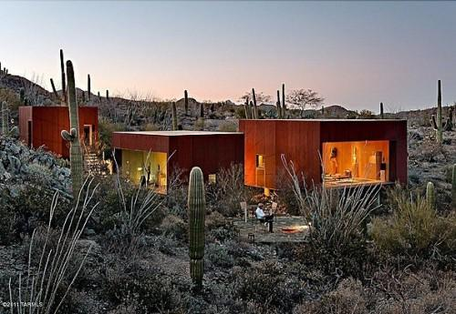 """<b>Desert Cubes</b><br> <a href=""""http://homes.yahoo.com/Arizona/Tucson/6353-w-sweetwater-dr:a6c84120ef739dd787460de998a5ad5b"""" data-ylk=""""slk:6353 W Sweetwater Dr, Tucson, AZ"""" class=""""link rapid-noclick-resp"""">6353 W Sweetwater Dr, Tucson, AZ </a><br> For sale: $895,000<br><br> Three separate structures sitting among sage brush and desert rock make up an acclaimed home located outside Tucson. Each box is a different size and has a different purpose and view: One box is the living room, and its window faces east. The bedroom box faces south, and the office and guest box faces west."""
