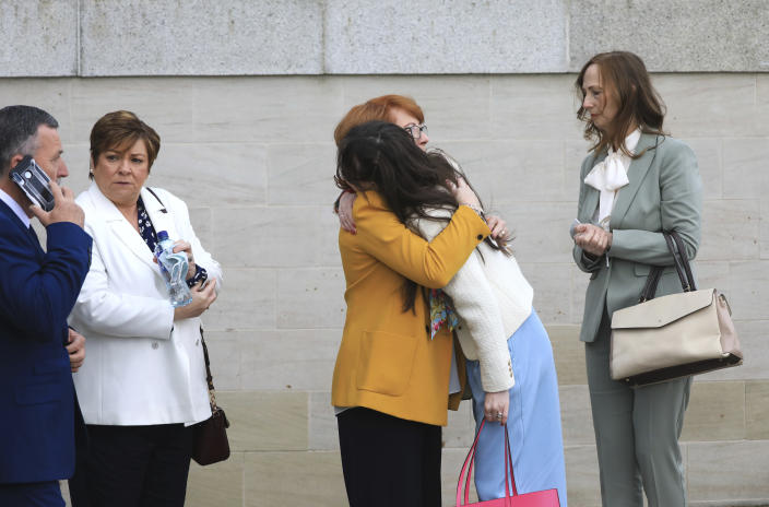 Rita Bonner, center left, sister of John Laverty who was shot, with relatives arrive for the inquest into the Ballymurphy shooting, in Belfast, Northern Ireland, Tuesday May 11, 2021. The findings of the inquest into the deaths of 10 people during an army operation in August 1971 is due to be published on Tuesday. (AP Photo/Peter Morrison)