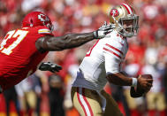 <p>Jimmy Garoppolo #10 of the San Francisco 49ers tried to avoid the sack attempt of Allen Bailey #97 of the Kansas City Chiefs during the fourth quarter of the game at Arrowhead Stadium on September 23rd, 2018 in Kansas City, Missouri. (Photo by David Eulitt/Getty Images) </p>