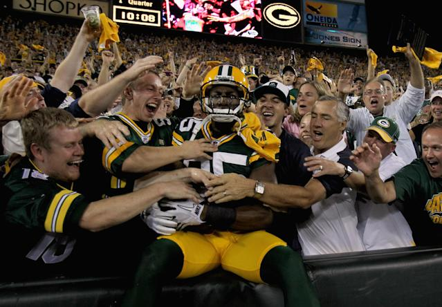 GREEN BAY, WI - SEPTEMBER 08: Greg Jennings #85 of the Green Bay Packers celebrates after scoring a touchdown in the first quarter against the New Orleans Saints during the season opening game at Lambeau Field on September 8, 2011 in Green Bay, Wisconsin. (Photo by Jonathan Daniel/Getty Images)