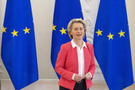 """FILE- In this file photo dated Friday, July 2, 2021, European Commission President Ursula von der Leyen arrives for a meeting in Vilnius, Lithuania. European Union chief Ursula von der Leyen on Thursday July 22, 2021, has flatly refused to renegotiate a post-Brexit trade deal with the U.K. after a Prime Minister Boris Johnson urged the bloc to work with British officials to find """"practical solutions"""" to red tape and inspections that are causing shortages in Northern Ireland. (AP Photo/Mindaugas Kulbis, FILE)"""