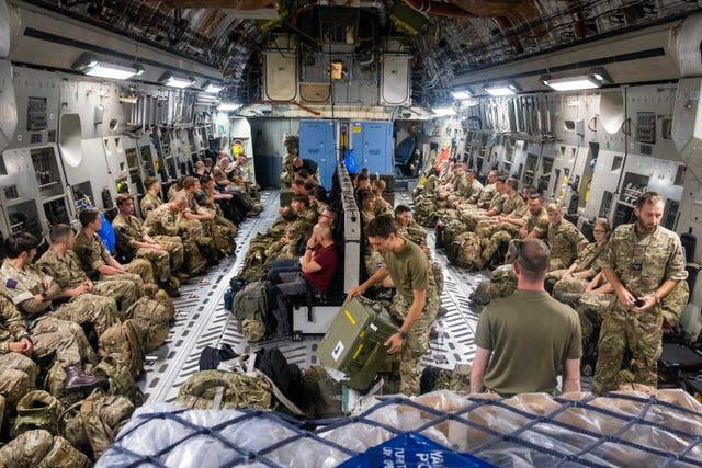 British troops on a flight to Afghanistanitting deployment to Afghanistan