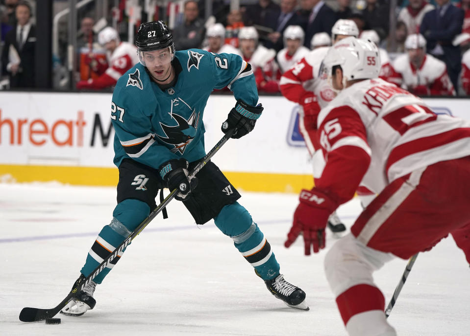 San Jose Sharks right wing Joonas Donskoi (27) moves the puck past Detroit Red Wings defenseman Niklas Kronwall (55) during the first period of an NHL hockey game Monday, March 25, 2019, in San Jose, Calif. (AP Photo/Tony Avelar)