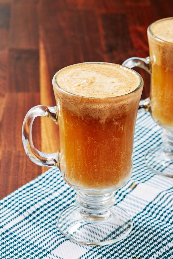 """<p>This rum-based drink is literally covered in sweet buttered rum batter.</p><p>Get the recipe from <a href=""""https://www.delish.com/cooking/recipes/a50396/hot-buttered-rum-recipe/"""" rel=""""nofollow noopener"""" target=""""_blank"""" data-ylk=""""slk:Delish"""" class=""""link rapid-noclick-resp"""">Delish</a>.</p>"""