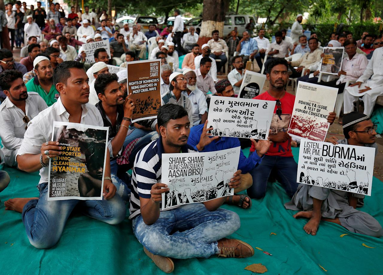 People hold placards during a protest against what they say is Myanmar's persecution of Rohingya Muslims, in Ahmedabad, India September 18, 2017. REUTERS/Amit Dave