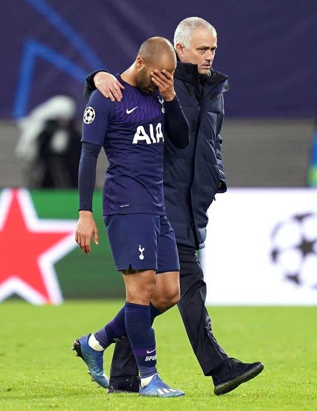 Jose Mourinho consoles Lucas Moura, left, after Spurs' Champions League defeat to Leipzig