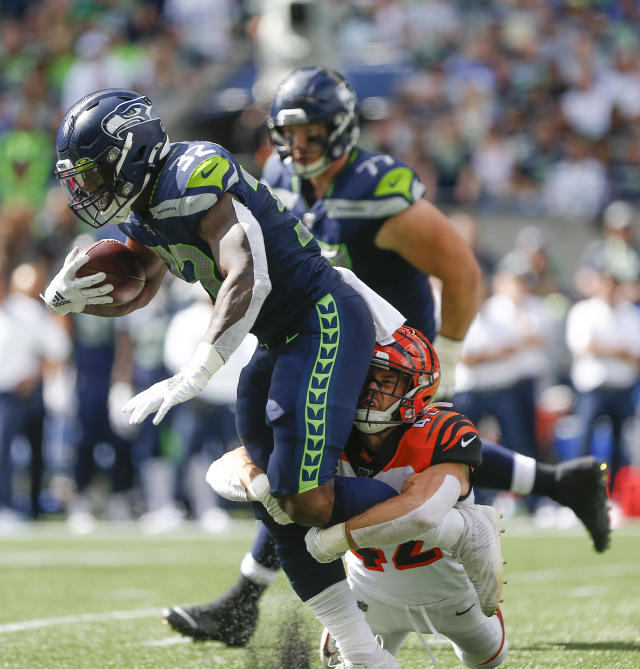 Chris Carson #32 of the Seattle Seahawks is tacked by Clayton Fejedelem #42 of the Cincinnati Bengals in the first quarter at CenturyLink Field on September 8, 2019 in Seattle, Washington. (Photo by Lindsey Wasson/Getty Images)