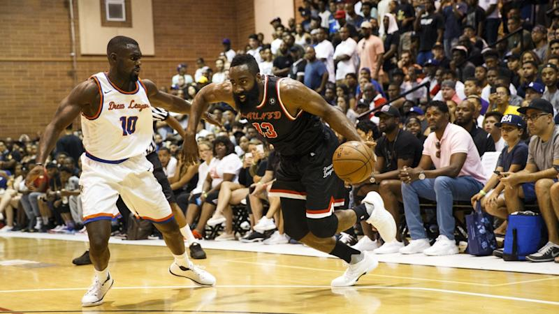 Rockets' James Harden, right, and Hawks' Tim Hardaway Jr. play the Drew League in 2017.