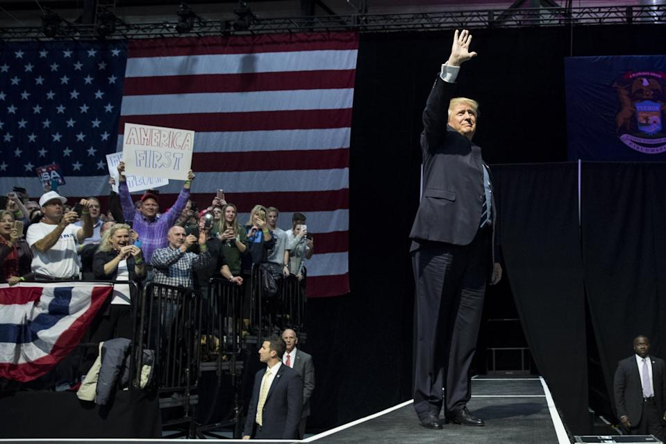 President-elect Donald Trump waves to the crowd as he arrives onstage at the DeltaPlex Arena, December 9, 2016, in Grand Rapids, Michigan. President-elect Donald Trump is continuing his victory tour across the country.