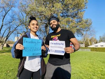 Jenifer Anthonipillai (left) and Mirun Nagarajah (right), walk for their grandmother in Mississauga, Ontario, in support of the IG Wealth Management Walk for Alzheimer's. (CNW Group/Alzheimer Society of Canada)