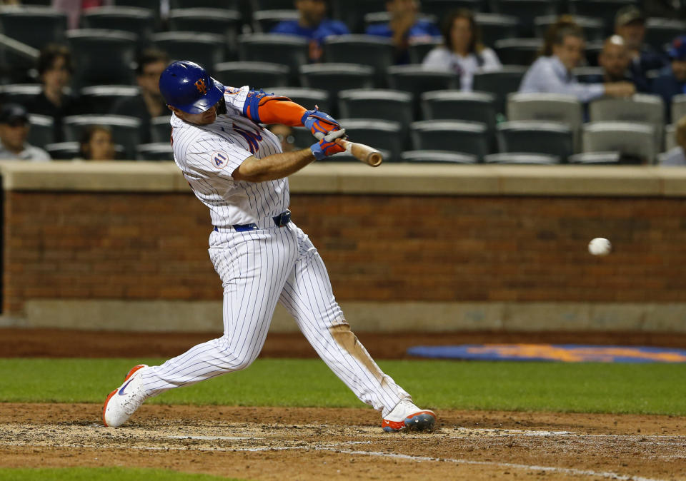 New York Mets first baseman Pete Alonso hits a single against the Atlanta Braves during the seventh inning of a baseball game Wednesday, June 23, 2021, in New York. (AP Photo/Noah K. Murray)