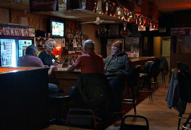"""PHOTO: Inside Club 51, the only bar in downtown Postville, Ia., a group of local men play cards and discuss immigration. """"I'm for the wall 100%,"""" said one resident, who asked to remain anonymous, speaking with ABC News. (ABC News )"""