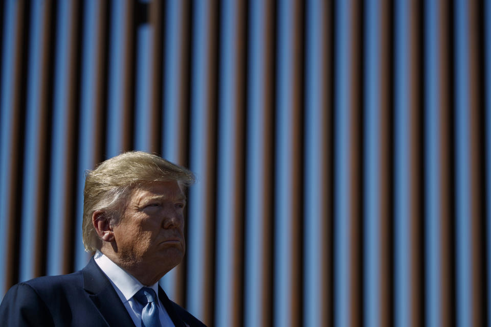 President Donald Trump tours a section of the southern border wall, Wednesday, Sept. 18, 2019, in Otay Mesa, Calif. (AP Photo/Evan Vucci)