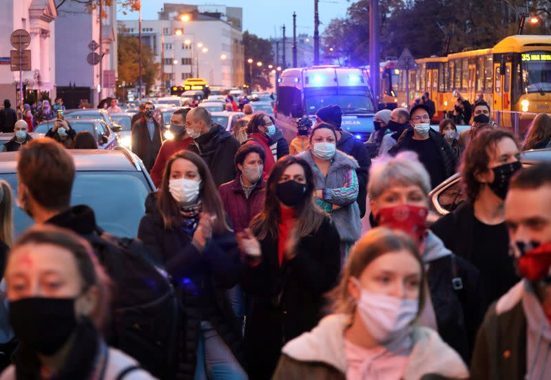 FILE PHOTO: People protest against imposing further restrictions on abortion law in Warsaw