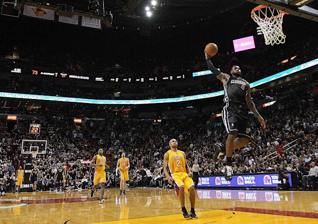 MIAMI, FL - JANUARY 19: LeBron James #6 of the Miami Heat dunks during a game against the Los Angeles Lakers at American Airlines Arena on January 19, 2012 in Miami, Florida. NOTE TO USER: User expressly acknowledges and agrees that, by downloading and/or using this Photograph, User is consenting to the terms and conditions of the Getty Images License Agreement. (Photo by Mike Ehrmann/Getty Images)