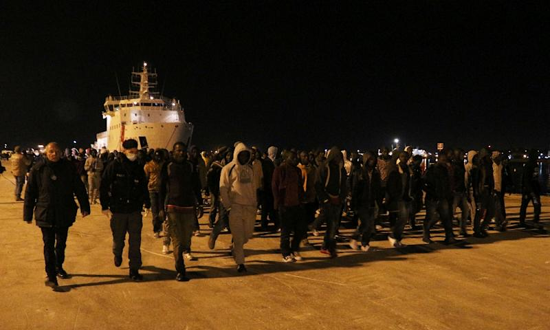 Migrant disembark from a ship on March 4, 2015 in the port of Augusta, Sicily, after a rescue operation off the coast