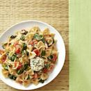 <p>This vegetarian pasta recipe is loaded with fresh vegetables--sweet spring onions, tangy cherry tomatoes and plenty of baby spinach. Goat cheese medallions are coated with panko and lightly crisped under the broiler, making this a restaurant-worthy yet super-simple and impressive weeknight dinner.</p>