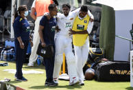 Sri Lanka's Dhananjaya de Silva leaves the field of play injured on day one of the first cricket test match between South Africa and Sri Lanka at Super Sport Park Stadium in Pretoria, South Africa, Saturday, Dec. 26 2020. (AP Photo/Catherine Kotze)