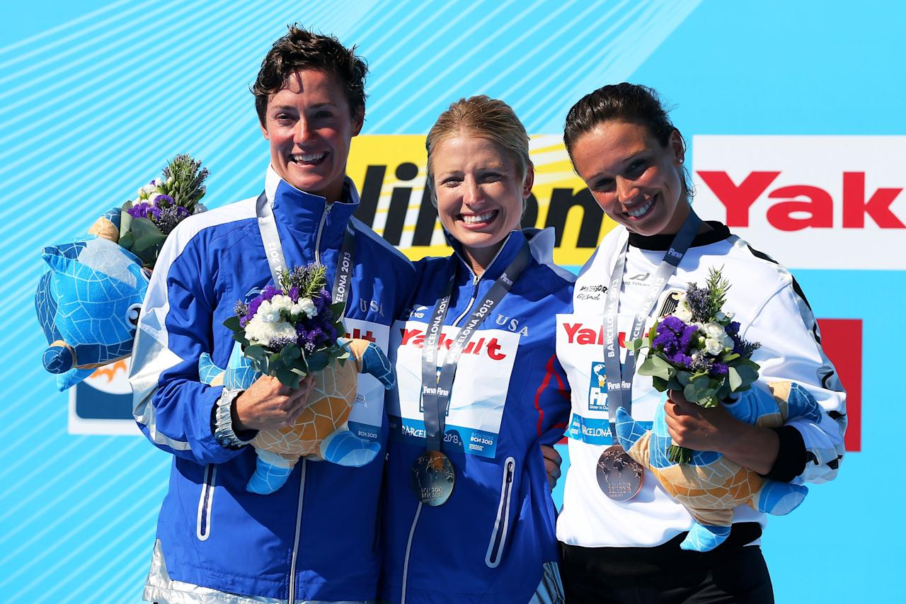 BARCELONA, SPAIN - JULY 30: (L-R) Silver medal winner Ginger Huber of USA, Gold medal winner Cesilie Carlton of the USA and Bronze medal winner Anna Bader of Germany celebrate on the podium after the Women's 20m High Diving on day eleven of the 15th FINA World Championships at Moll de la Fusta on July 30, 2013 in Barcelona, Spain. (Photo by Quinn Rooney/Getty Images)