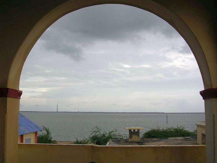 A view from Kothandaramaswamy Temple, located 12 km from Rameswaram. Popular belief goes that Vibishana, brother of the demon king Ravana of Lanka, surrendered before Lord Rama here. The mythological importance assigned to this town is that when Lord Rama returned to India after vanquishing Ravana, Vibhishana pleaded with him to break the setu (bridge) so that no other armies would use it. Rama acquiesced to his request and broke the Indian side of the bridge with the end of his bow. This place came to be known as Dhanushkodi (Dhanush is 'bow' and kodi is 'end' in Tamil) and remains to this day a holy place for Hindus.