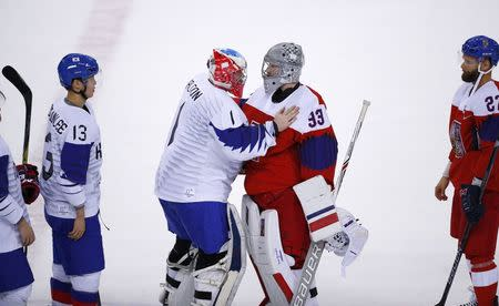 Ice Hockey – Pyeongchang 2018 Winter Olympics – Men Preliminary Round Match – Czech Republic v South Korea - Gangneung Hockey Centre, Gangneung, South Korea – February 15, 2018 - Goalies Matt Dalton of South Korea (L) and Pavel Francouz of the Czech Republic greet each other after the game. REUTERS/Brian Snyder