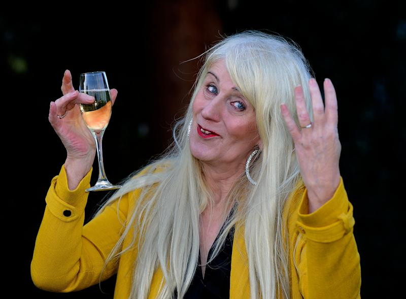 Taxi driver Melissa Ede, 57, celebrating during a photocall at Willerby Manor Hotel in Hull after her £4m Scratchcard win on New Year's Day.