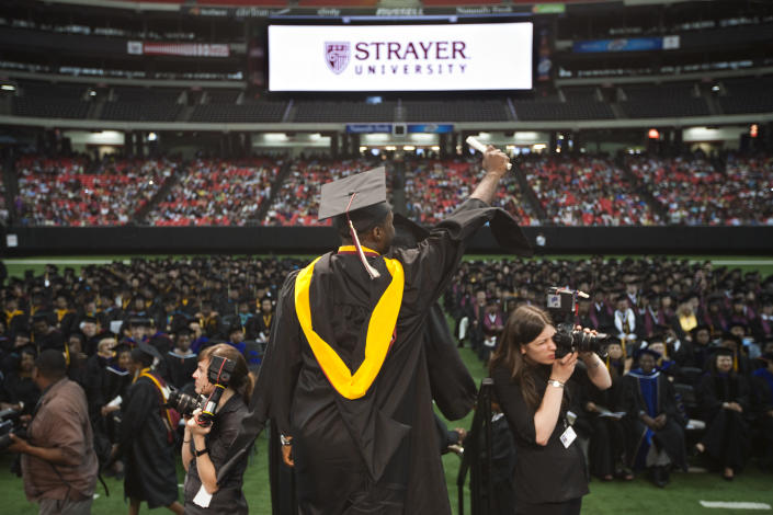 A commencement ceremony for Strayer University, a private, for-profit educational institution. Strayer University specializes in higher education for working adults seeking career advancement. (PHOTO: Brooks Kraft LLC/Corbis via Getty Images)