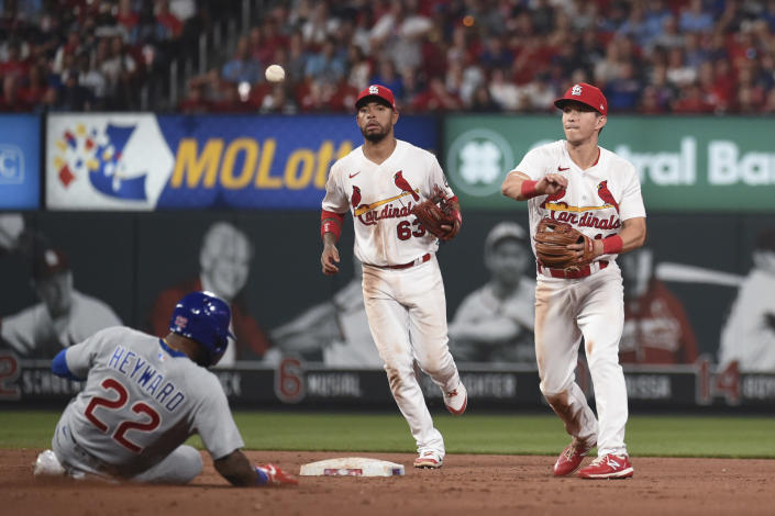 Chicago Cubs' Jason Heyward, left, is out at second as St. Louis Cardinals second baseman Tommy Edman, right, throws out Cubs' Robinson Chirinos during the seventh inning of a baseball game Thursday, July 22, 2021, in St. Louis. (AP Photo/Joe Puetz)