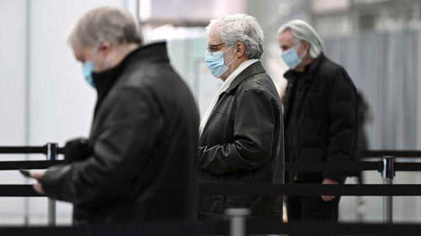 PHOTO: People stand in check-in lines to receive the COVID-19 vaccine inside the Jacob K. Javits Convention Center which opens today as a state-run COVID-19 vaccine site, New York, Jan. 13, 2021. (Anthony Behar/Sipa USA via AP)