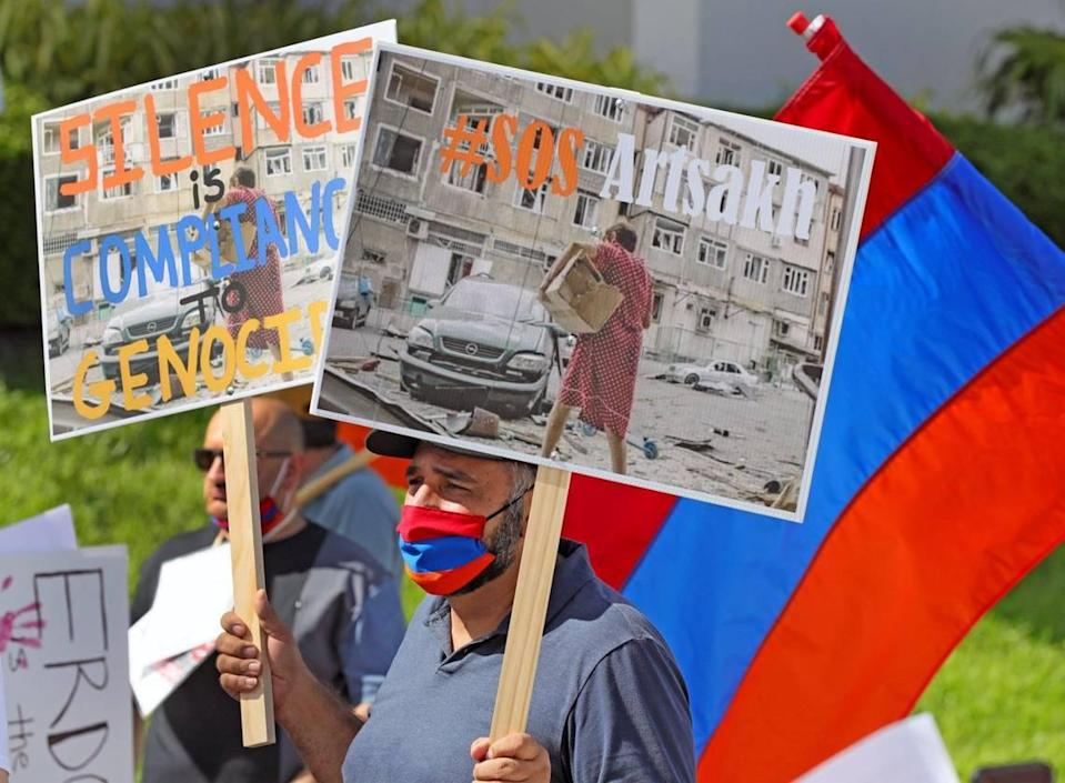 Mihran Vardanyan protests against the government of Azerbaijan, and stands in favor of national independence for the Republic of Artsakh during a rally on Miami Beach on Friday, October 23, 2020.