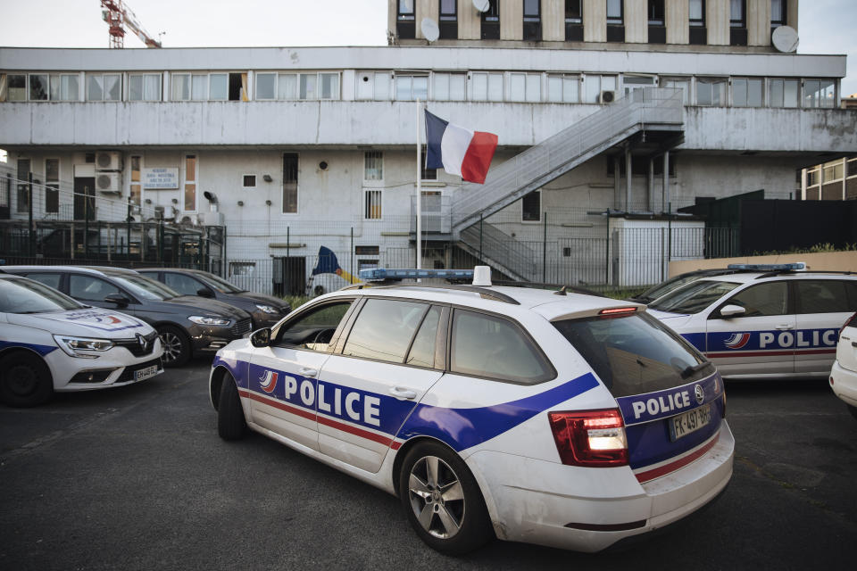 A police car arrives at the police station in the Paris suburb of Sarcelles, Tuesday, June, 15, 2021. The police station in Sarcelles was attacked in February by youths who launched noisy fireworks and threw stones, according to authorities. No injuries were reported but the attack was one of several targeting police stations that have heightened anxiety in police ranks. (AP Photo/Lewis Joly)