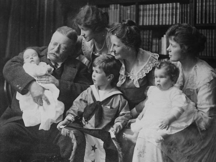 Theodore Roosevelt poses for a family portrait with his wife and children.