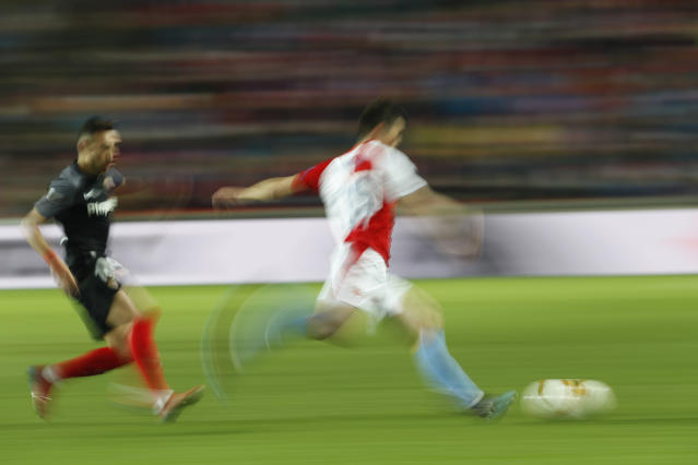 Sevilla's Munir, left, and Slavia's Ondrej Kudela vie for the ball during their Europa League Round of 16 second leg soccer match between Slavia Praha and Sevilla at the Sinobo stadium in Prague, Czech Republic, Thursday, March 14, 2019. (AP Photo/Petr David Josek)