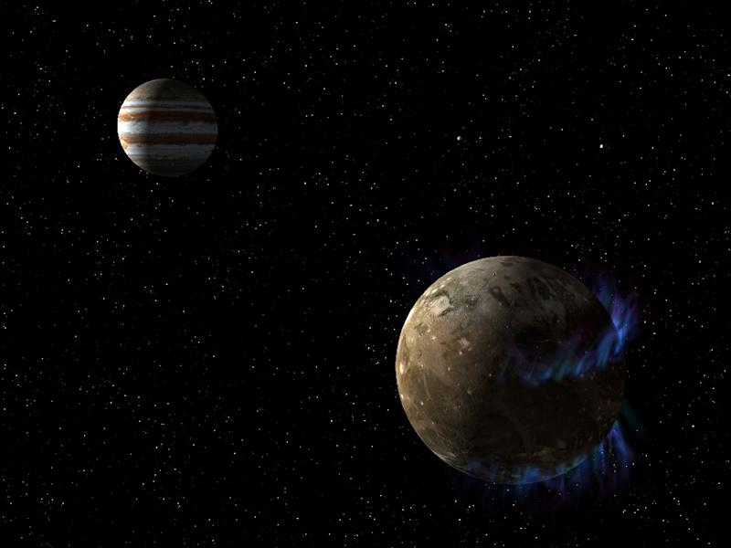 This NASA /ESA artist's concept, obtained March 12, 2015, shows the moon Ganymede as it orbits the giant planet Jupiter