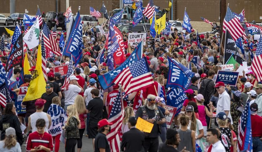 PHOENIX, AZ - NOVEMBER 6, 2020: A crowd of about 1,000 pro-Trump supporters gather in the parking lot outside the Maricopa county elections building to protest election results on November 6, 2020 in Phoenix, Arizona.(Gina Ferazzi / Los Angeles Times)