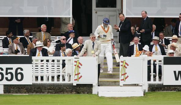 LONDON - JUNE 14:  VVS Laxman of the MCC XI iis applauded onto the pitch by a scattering of MCC members during the Tsunami Relief Match between MCC XI and International XI, at Lord's Cricket Ground on June 14, 2005 in London, England.  (Photo by Clive Mason/Getty Images)
