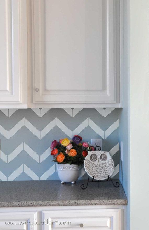 """If goldleaf and petrified-wood backsplashes are too rich for your taste, try out these <a href=""""http://etsy.me/UxJqBB"""" rel=""""nofollow noopener"""" target=""""_blank"""" data-ylk=""""slk:chevron pattern decals from Abby's Vinyl Wall Art on Etsy"""" class=""""link rapid-noclick-resp"""">chevron pattern decals from Abby's Vinyl Wall Art on Etsy</a>. An extra-large sheet is $35 and covers about 18 inches by 12 inches. They're available in multiple colors."""