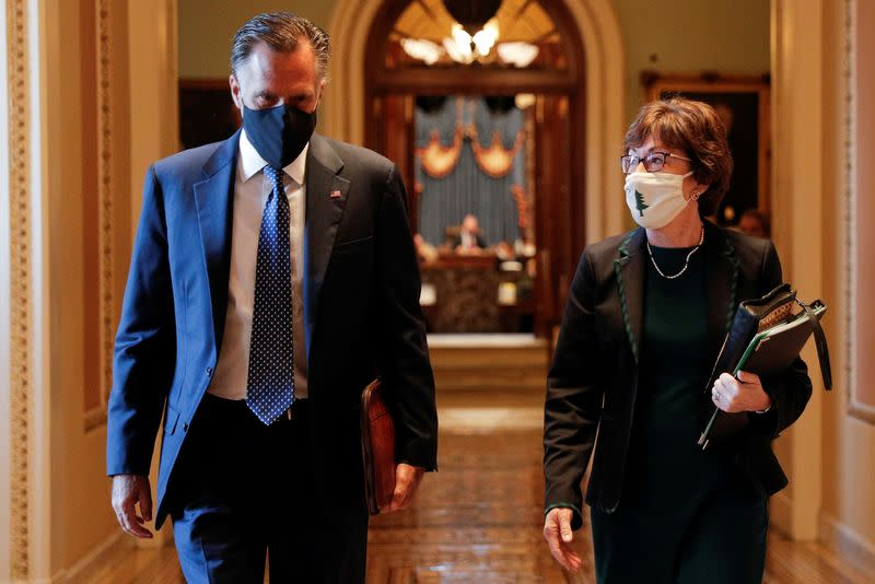 FILE PHOTO: Senators Romney and Collins walk to the office of the Majority Leader from the Senate Chamber ahead of a meeting with Majority Leader McConnell on Capitol Hill in Washington